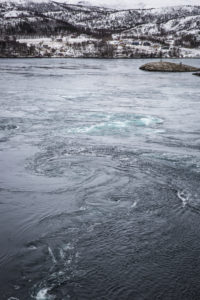Eddies forming in the fast flowing currents of the Saltstraumen maelstrom, Nordland, Norway
