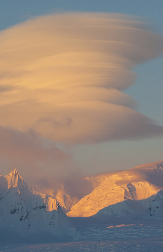 Lenticular clouds over the mountains of Antarctica.